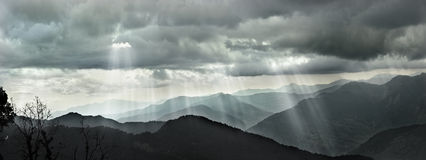 Clouds and sunlight in mountain of the Himalayas, grayscale Royalty Free Stock Images