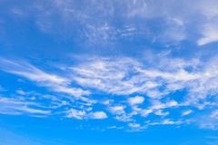 Clouds on a sunny blue sky. Heavenly background