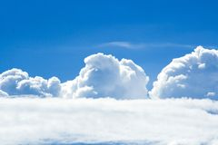 Clouds on a sunny day. Cumulus and cumulonimbus clouds in a clear sky Royalty Free Stock Image
