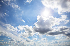 Clouds on sunny sky. Beautiful white clouds on sunny sky stock photo