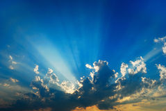 Clouds and sunrays background. Sunrays and clouds on a blue sky day Royalty Free Stock Image