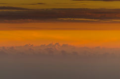 Clouds in the sunrise on horizon. Many clouds in the warm sunrise on the horizon Royalty Free Stock Photography