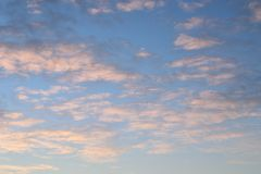 Clouds in the sunrise. White and grey clouds in the sunrise Royalty Free Stock Image