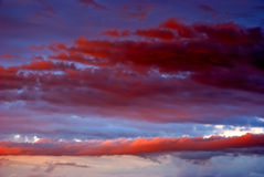Clouds on a sunset. Are painted by the sun in red color Stock Images