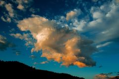 Clouds at Sunset in Estes Park, Colorado. This beautiful cloud looked like it was on fire when the sun started to set in Estes Park, Colorado stock photo
