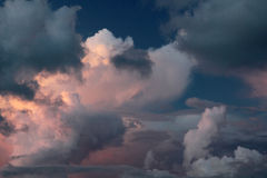 Clouds in the sunset. Evening view of the sky, clouds in the sunset, before the rain Royalty Free Stock Image