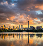 Clouds at sunset, Manhattan skyscrapers across Central Park Stock Image