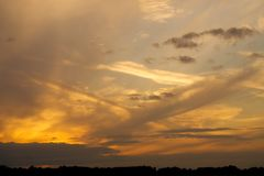 Clouds at sunset. Multi level array of cloud as the sun goes down Stock Photo