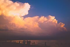 Clouds at Sunset Over Beach Stock Images