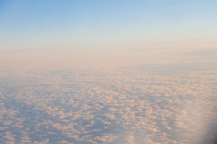 Clouds at sunset from the plane in the sky landscape Royalty Free Stock Image