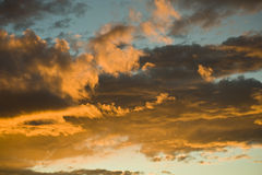 Clouds in sunset sky, France, Anthon. Colored louds in sunset sky, France, Anthon Stock Photos