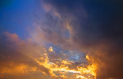 Clouds, sunset. The sky after the rain. Dramatic sky. Orange and yellow clouds. stock image