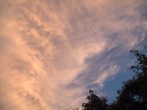 Clouds. After sunset with tecnicolor and changing shapes Stock Photography