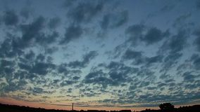 Clouds at sunset. Timelapse. Urban landscape, timelapse clouds at sunset stock video footage