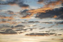 Clouds at sunset with vivid colors Stock Photos