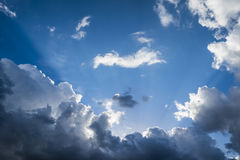 Clouds with sunshine. Beautiful storm clouds with sun beams Royalty Free Stock Image