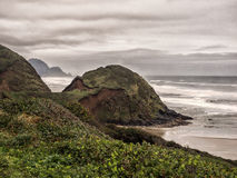 Clouds and surf. A cold winter cloudy sky over the long waves of a sandy beach on the Oregon coast Stock Photo