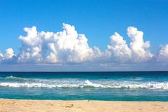 Clouds and Surf Royalty Free Stock Image
