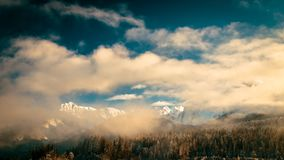 Mangart capped by the fog in a winter day Royalty Free Stock Photo