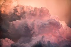 Clouds at susnet. Evening storm clouds in brilliant color at sunset Stock Photos
