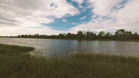 Clouds swim over the river in summer. Clouds swim over the river in summer stock footage