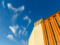 Clouds. Swirling over old grain silos Royalty Free Stock Image