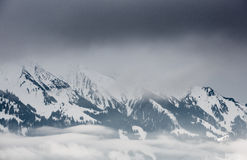 Clouds in swiss alps in winter Royalty Free Stock Photo