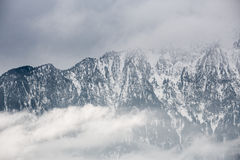 Clouds in swiss alps in winter Stock Photography