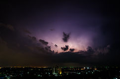 Clouds and thunder lightnings and storm in the city Royalty Free Stock Image