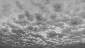 Clouds time lapse. Dark dense black and white sunset clouds time lapse ultra hd, 4K resolution, 30fps stock video footage