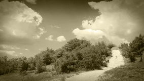 Clouds Time Lapse over country road: old film footage Royalty Free Stock Photos