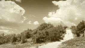 Clouds Time Lapse over country road: old film footage.  stock video
