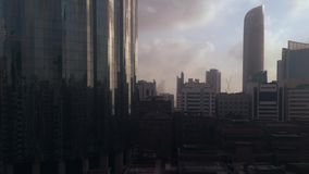 Clouds timelapse around city`s skyscrapers at sunset - Abu Dhabi skyline and World Trade Center.  stock footage