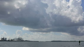 Clouds timelapse stock video footage. Timelapse video of clouds rolling over the Port of Miami stock footage