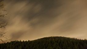 Clouds timelapse. Clouds time lapse in spring season over fir tree hill stock video