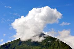 Clouds on top of hills Royalty Free Stock Image