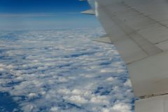 Clouds. top view from the window of an airplane flying in the clouds. cloud spreading the horizon. Clouds. top view from the window of an airplane flying in the Stock Photos