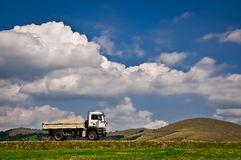 Clouds and truck Royalty Free Stock Images