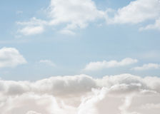 Clouds under a bright blue sky Stock Photography
