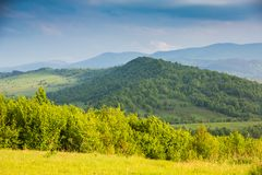 Clouds under mountains and sun glade.Contrast of colors. Clouds under mountains and sunny glade.Contrast of colors. Spring in mountains.Landscape Carpathians royalty free stock photos