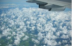 Clouds under the plane wing. White cloud in blue sky under the aircraft wing Stock Photos