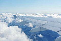 Clouds under the wing of an airplane Royalty Free Stock Photo
