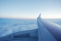 Clouds under the wing of an airplane Royalty Free Stock Image