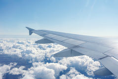 Clouds under the wing of an airplane Royalty Free Stock Photos