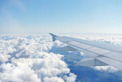 Clouds under the wing of an airplane Royalty Free Stock Images