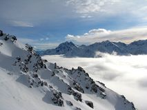 Clouds in a valley in Alps. Beautiful view over valley in Austrian Alps Stock Images