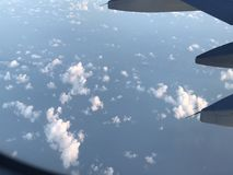 Sky High. Clouds in view as I fly to Royalty Free Stock Images