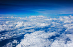 Clouds view from the window of an airplane flying Stock Photo