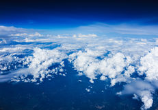 Clouds view from the window of an airplane flying Royalty Free Stock Image