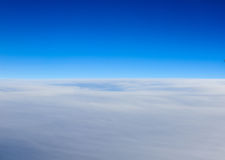 Clouds view from the window of an airplane flying Royalty Free Stock Images